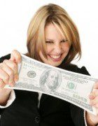 Smiling woman stretches a dollar