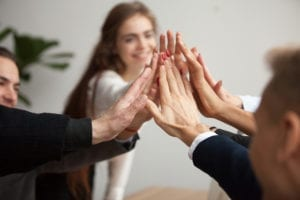 Motivated Successful Business Team Giving High Five