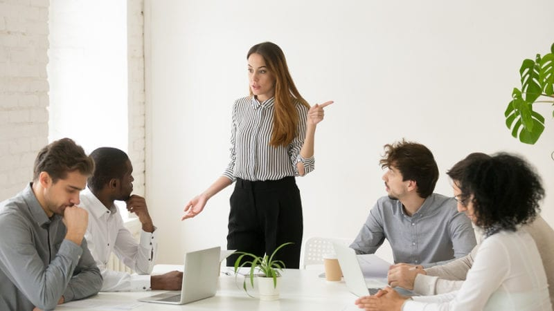 Business people having conflict at group meeting
