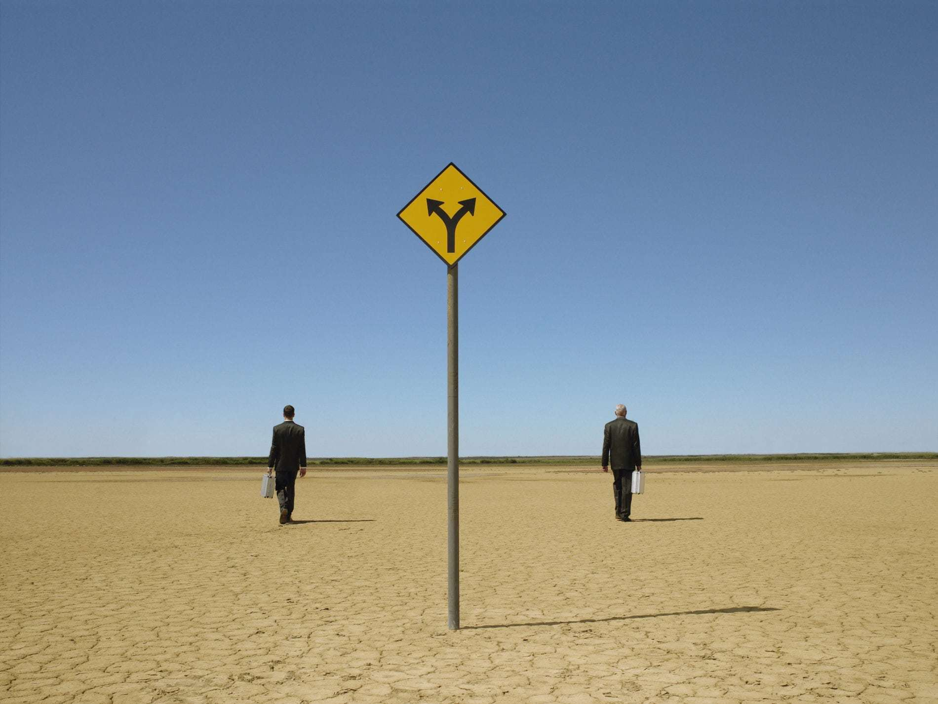 man with suitcase - crossroad sign image