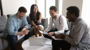 Happy diverse team people laughing working together at corporate briefing