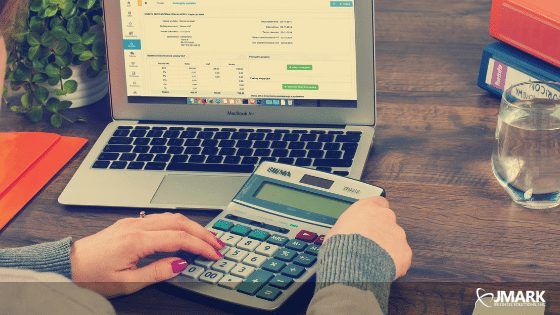 Laptop and Calculator - Accounting concept