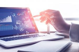 Businessman using modern laptop with graph.Business startup.Analyze strategy concepts Businessman using modern laptop with graph.Business startup.Analyze strategy concepts Strategy text with business icon on modern laptop screen with graph chart backgroun