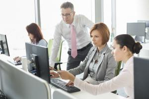 Business people working on computer in office