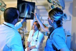 Medical doctors and a nurse looking at x-ray - a series of emergency room photos.