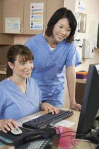Nurses working in doctor's office on computer IT support technology support for healthcare