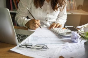 Budget planning concept,Accountant is calculating company's annual tax.Calendar 2019 and personal income tax forms for those who have income under US law placed on office desk.This is the season to pay taxes.