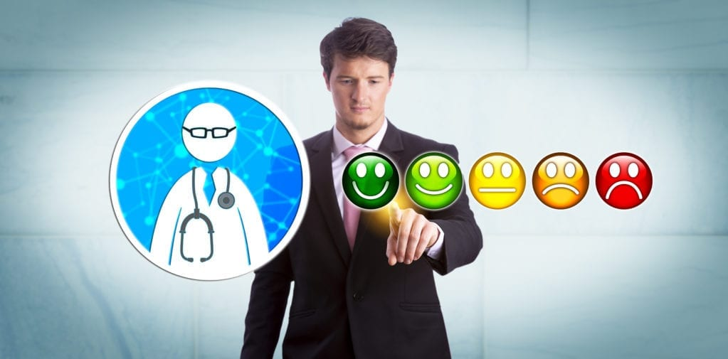 Young smiling business manager is giving a very good rating to a general practitioner via online app. Healthcare technology concept for customer feedback, technology savvy healthcare consumer.