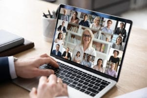 Diverse people engaged in group video call, computer monitor view