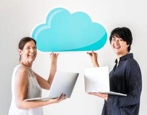 White woman using computer cloud network