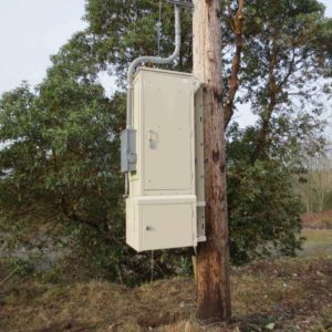 Puget Sound Energy Pole mount modular enclosure with battery backup and air conditioning option for Telecom industry.