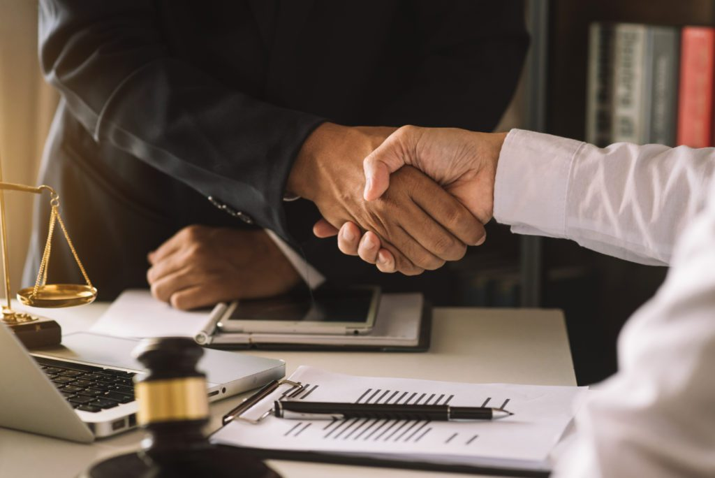 Bankruptcy lawyer shakes hands with client