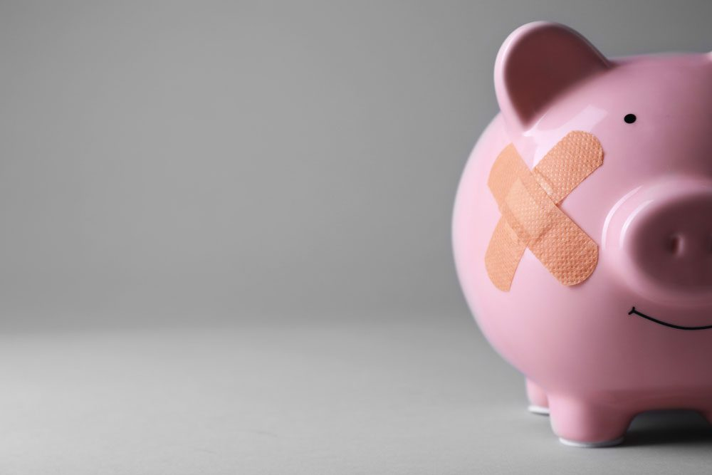 Piggy bank with bandaid - chapter 7 bankruptcy