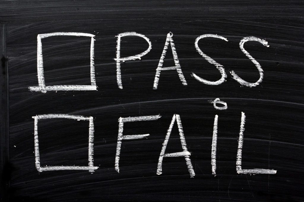 Tick boxes for pass or fail on a blackboard