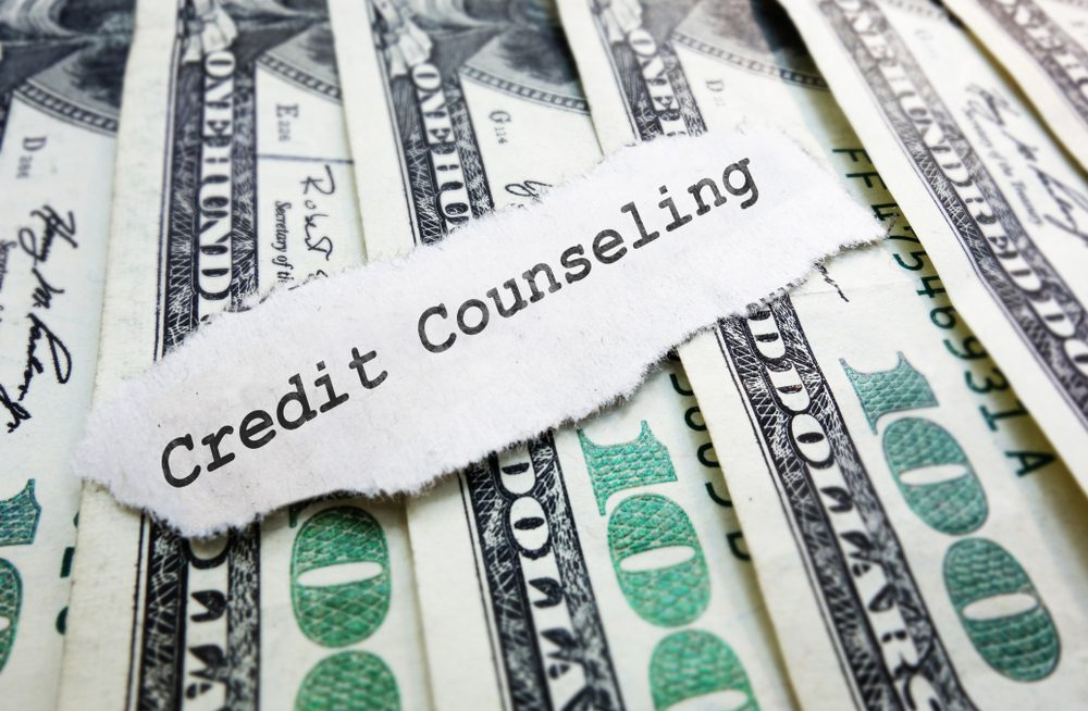 Words credit counseling placed over $100 bills