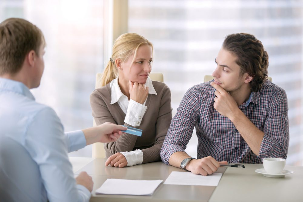 Couple Looking Sideways at Each Other During Counseling