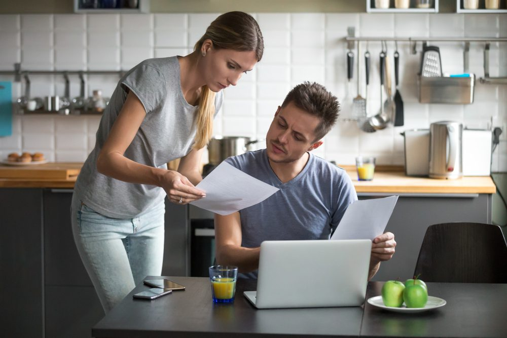 Serious millennial couple considering bankruptcy
